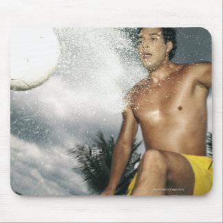 Low angle view of a man playing beach volley mouse pad