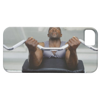 Low angle view of a mid adult man exercising in iPhone 5 covers