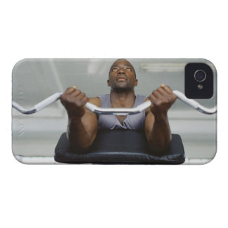 Low angle view of a mid adult man exercising in iPhone 4 cases