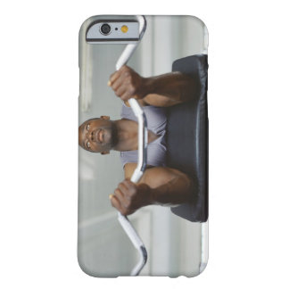 Low angle view of a mid adult man exercising in barely there iPhone 6 case
