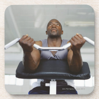 Low angle view of a mid adult man exercising in drink coaster