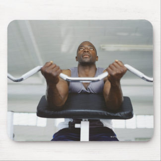 Low angle view of a mid adult man exercising in mouse pad