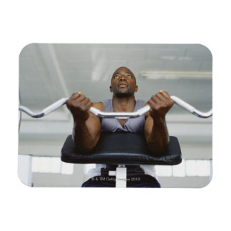 Low angle view of a mid adult man exercising in vinyl magnet