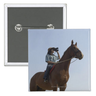 Low angle view of a teenage girl riding a horse 2 inch square button