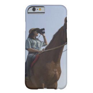 Low angle view of a teenage girl riding a horse barely there iPhone 6 case