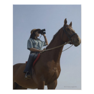 Low angle view of a teenage girl riding a horse poster