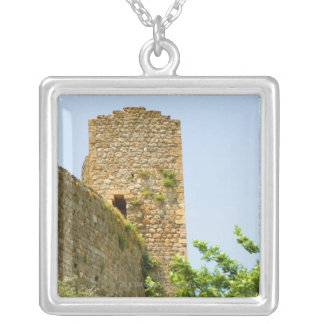 Low angle view of an ancient building, silver plated necklace