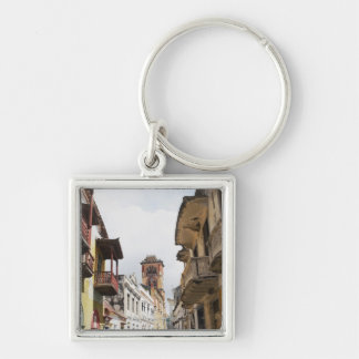 Low angle view of apartments along the street Silver-Colored square keychain