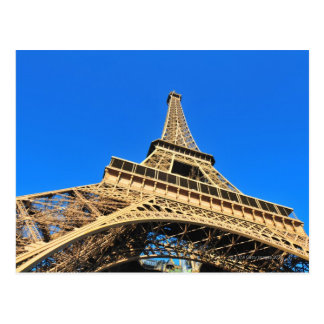 Low angle view of Eiffel Tower against blue sky Postcard