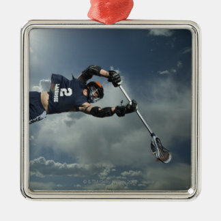 Low angle view of jai-alai player jumping christmas tree ornaments