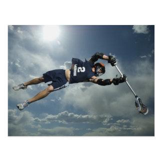 Low angle view of jai-alai player jumping postcard