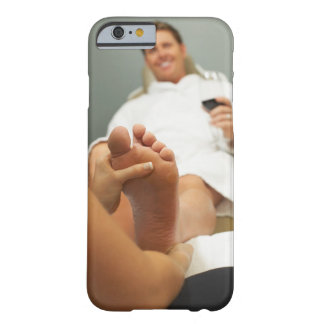 Low angle view of man receiving foot massage barely there iPhone 6 case