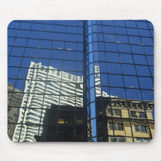 Low angle view of the reflection of buildings on mouse pad