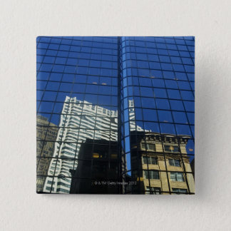 Low angle view of the reflection of buildings on pinback button