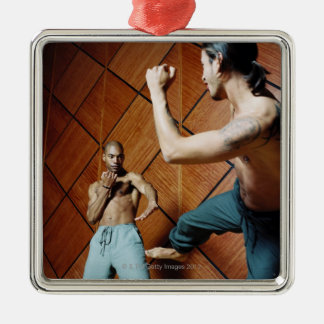 Low angle view of two young men practicing metal ornament