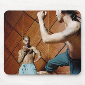 Low angle view of two young men practicing mouse pad