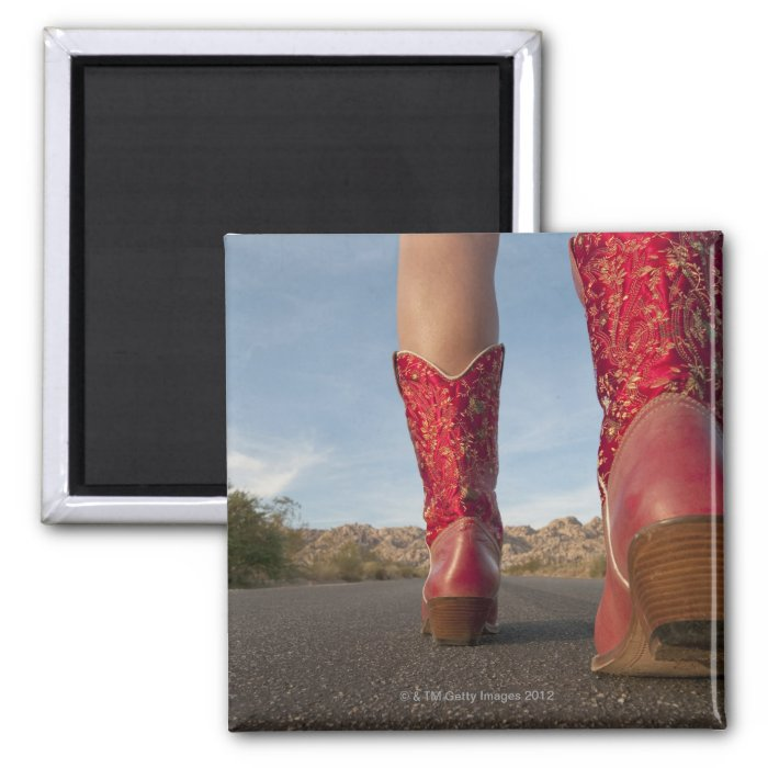 Low-angle view of woman wearing cowboy boots 2 inch square magnet