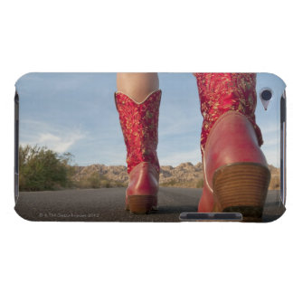 Low-angle view of woman wearing cowboy boots iPod touch covers