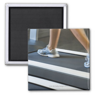 Low section of woman walking on treadmill 2 2 inch square magnet