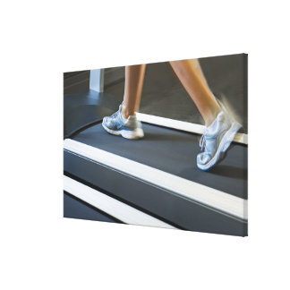 Low section of woman walking on treadmill 2 canvas print