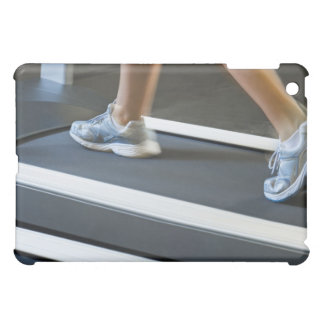Low section of woman walking on treadmill 2 case for the iPad mini