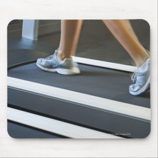 Low section of woman walking on treadmill 2 mouse pad