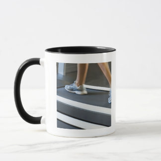Low section of woman walking on treadmill 2 mug
