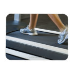 Low section of woman walking on treadmill 2 rectangular magnet