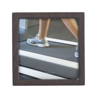 Low section of woman walking on treadmill 2 premium trinket boxes
