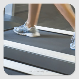 Low section of woman walking on treadmill 2 square sticker