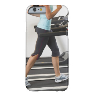 Low section of woman walking on treadmill barely there iPhone 6 case