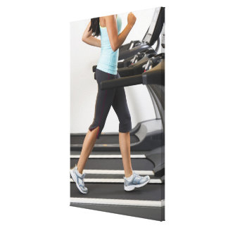 Low section of woman walking on treadmill canvas print