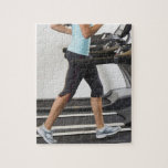 Low section of woman walking on treadmill puzzles