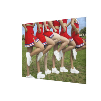 Low Section View of a Group of Cheerleaders Canvas Print