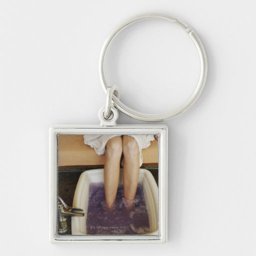 Low section view of a woman getting a pedicure Silver-Colored square keychain