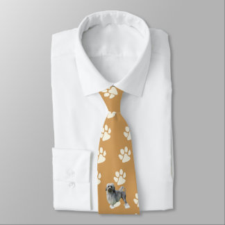 Lowchen, white paw prints on old gold tie