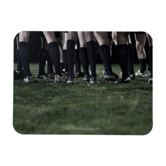 Lower section of a group of rugby players rectangular photo magnet