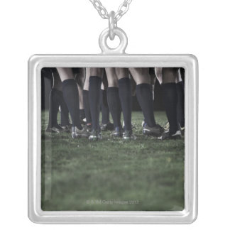 Lower section of a group of rugby players silver plated necklace