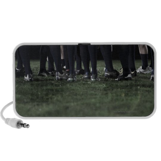 Lower section of a group of rugby players speaker