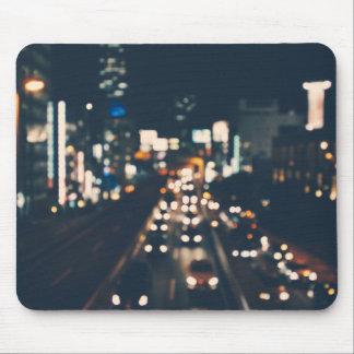 Luces borrosas de la ciudad tapetes de raton