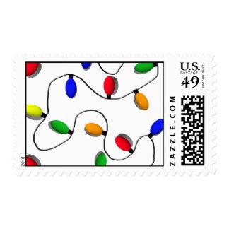 Luces coloridas del árbol de navidad timbre postal