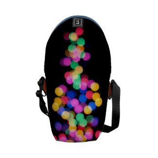 Luces de navidad borrosas bolsa de mensajeria