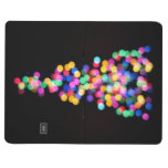 Luces de navidad borrosas cuaderno grapado