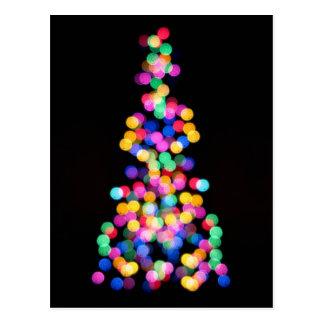 Luces de navidad borrosas postal