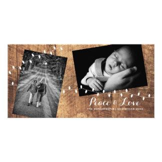 Luces derramadas navidad de madera de las fotos tarjeta personal