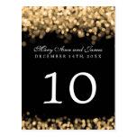 Luces elegantes del oro del número de la tabla tarjeta postal