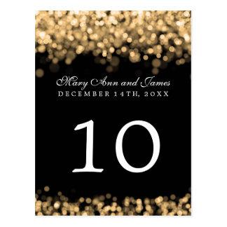 Luces elegantes del oro del número de la tabla postal