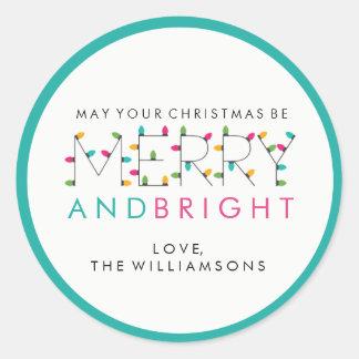 Luces festivas felices y brillantes del árbol de pegatina redonda