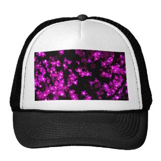 Luces rosadas de la flor que brillan intensamente gorros