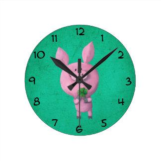 Lucky pig with lucky four leaf clover round clock